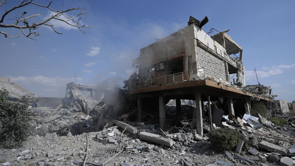 Damage is shown of the Syrian Scientific Research Center which was attacked by U.S., British and French military strikes to punish President Bashar Assad for suspected chemical attack against civilians, in Barzeh, near Damascus, Syria, Saturday, April 14, 2018.