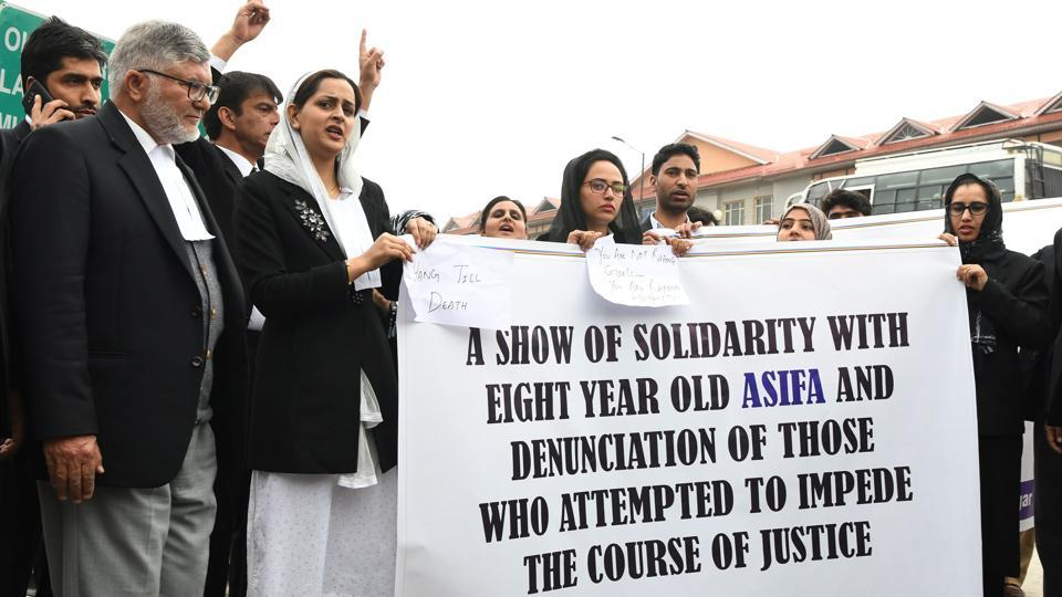 Kashmiri lawyers stand behind a banner during a protest calling for justice following the recent rape and murder case of an eight-year-old girl in Srinagar, on Monday.