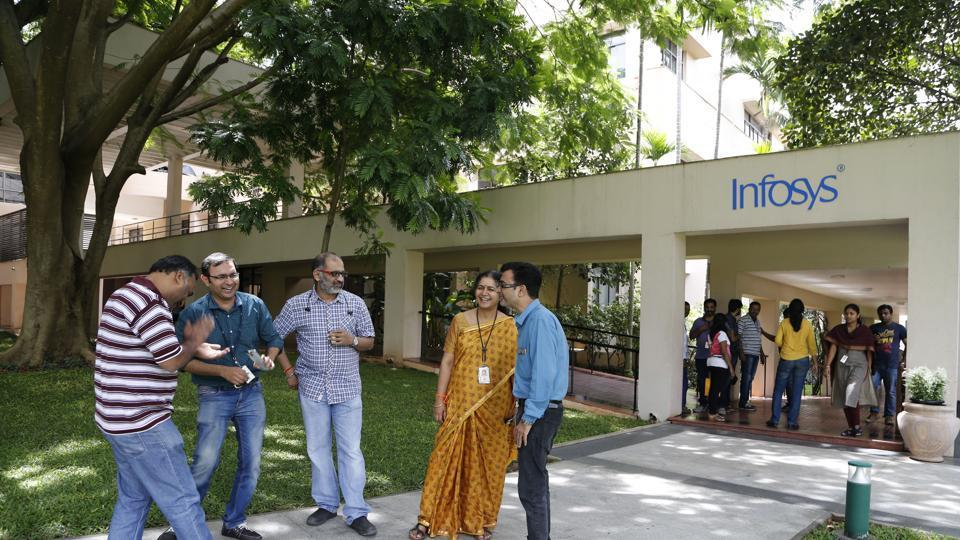 Infosys employees share a lighter moment during a break at the company headquarters in Bangalore, India.