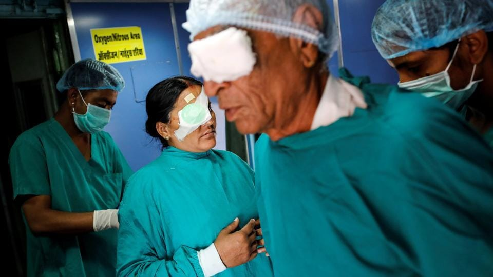 Patients with their eyes bandaged leave an operation theatre after cataract surgery, on the hospital train. Lifeline Express has treated about 1.2 million people since its launch in 1991 by the non-profit Impact India Foundation, said chief operating officer and doctor Rajnish Gourh. (Danish Siddiqui / REUTERS)
