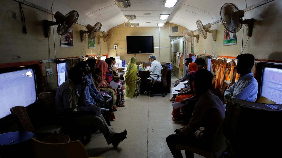 Patients wait for dental checkups on the Lifeline Express. Typically, it spends a month in a district, performing surgery ranging from cataracts and cancer to cleft palates and orthopaedics. The aim is not to compete with public healthcare, but support it. A second train is also in the works to cover the north and northeast. (Danish Siddiqui / REUTERS)