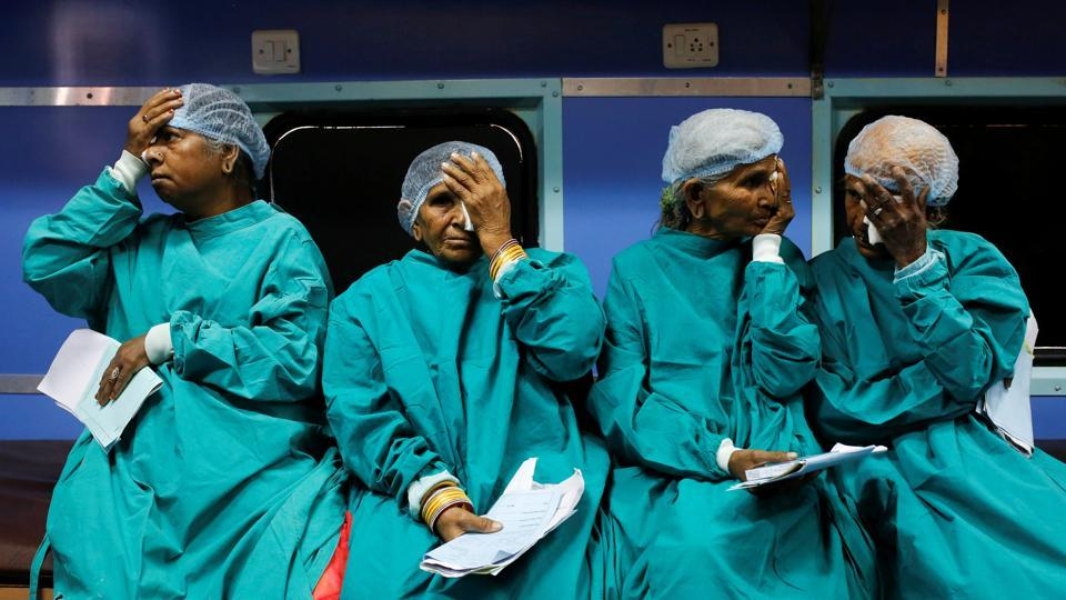 Patients cover their eyes as they wait before their cataract surgery on the Lifeline Express, at a railway station in Jalore, India. The Lifeline Express, a seven-coach train converted into a rolling hospital has crisscrossed India for 27 years to treat people living in areas with scarce healthcare. (Danish Siddiqui / REUTERS)