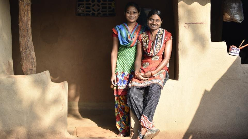 Most of the women are aged 18 to 45; high-school dropouts, former farm labourers, widows and single parents. Champa Atami (R), is both a dropout and former labourer. A new tin roof glints on her mud home. Where her parents – paddy farmers – couldn't afford her school fees, she is now saving up so her sister Ranjeeta, the youngest of four siblings, can graduate. (Sanchit Khanna / HT Photo)