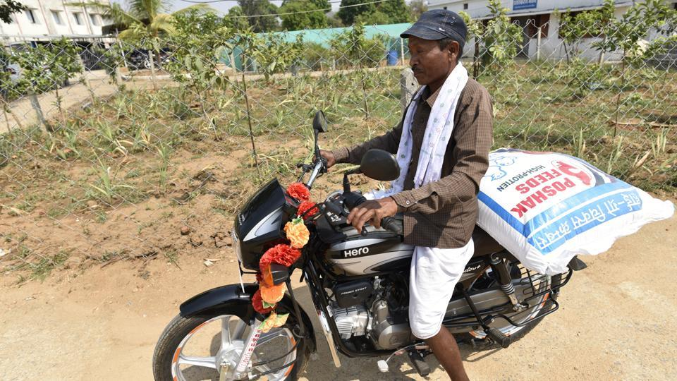 Sukalu Metam's new motorcycle was made possible by his wife Jhunni Netham's Kadaknath farm. Rearers get batches of 500 chicks that reach the target weight of 1.5 kg in three months and are sold to local traders or to a company tied with the district administration. A Kadaknath sells for Rs 400 to Rs 900 a piece — against Rs 150 to Rs 300 for a regular chicken. (Sanchit Khanna / HT Photo)