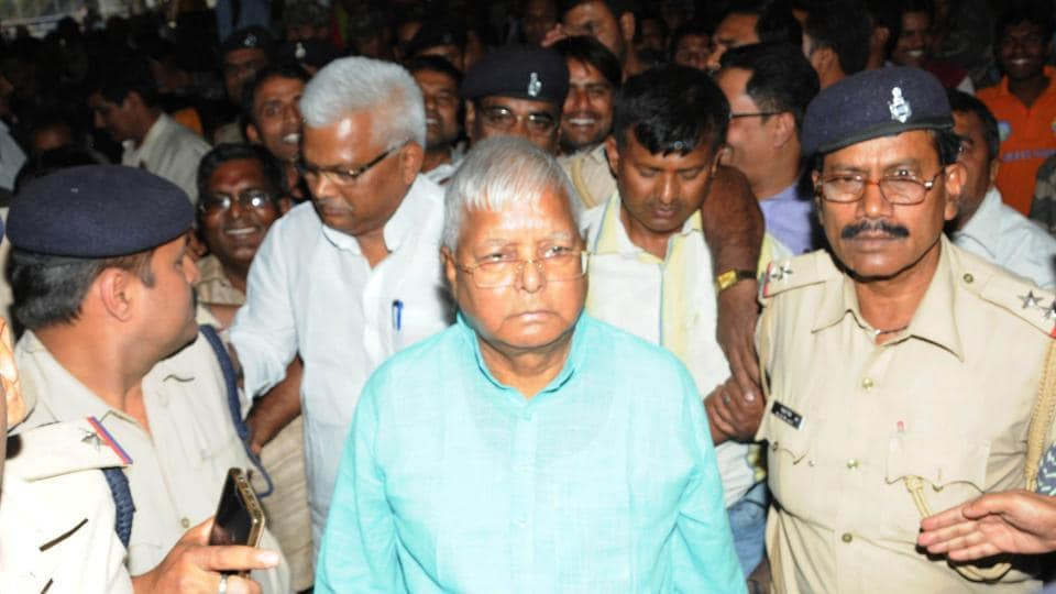 Convicted prisoner in a fodder scam RJD President Lalu Prasad with party workers at Ranchi railway station to board the New Delhi bound Rajdhani Express.