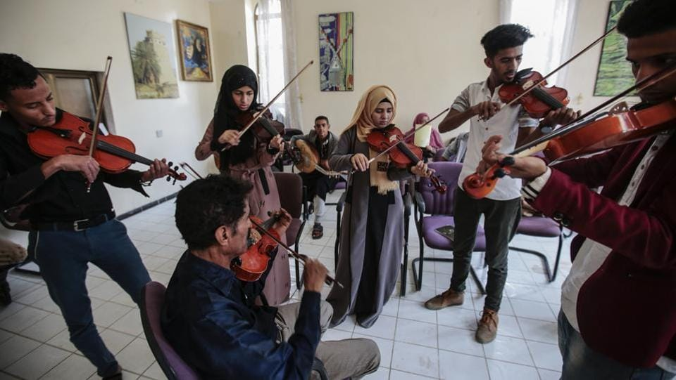 El-Deb'y (C), who is in his early 50s, has academic degrees in both Arabic and Western music and was part of a 40-musician national orchestra created in 1975 that eventually dissolved.  (Hani Mohammed / AP)