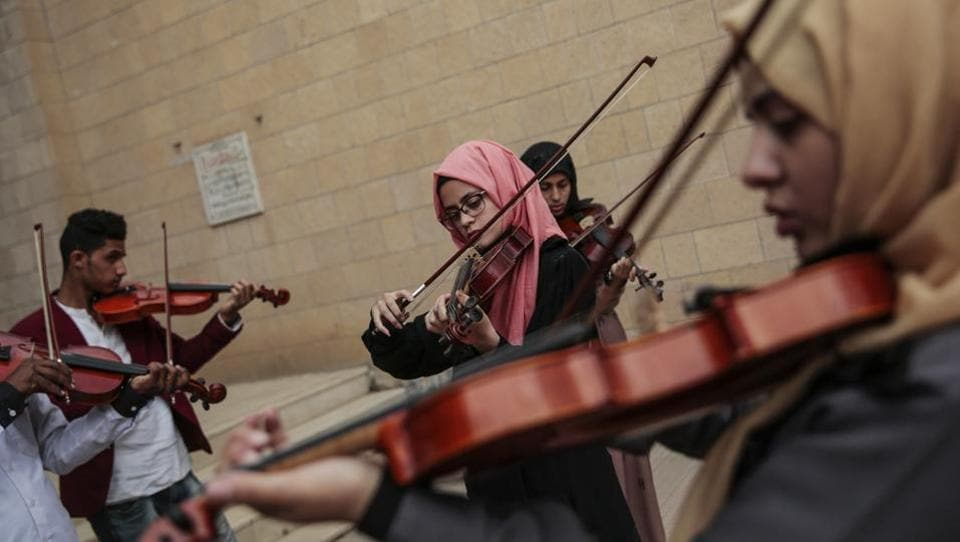Yemeni music students play violins during a music class at the Cultural Centre in Sanaa, Yemen. For the young people who receive lessons from Abdullah El-Deb'y, music is a safe haven from the misery of Yemen's devastating war. (Hani Mohammed / AP)