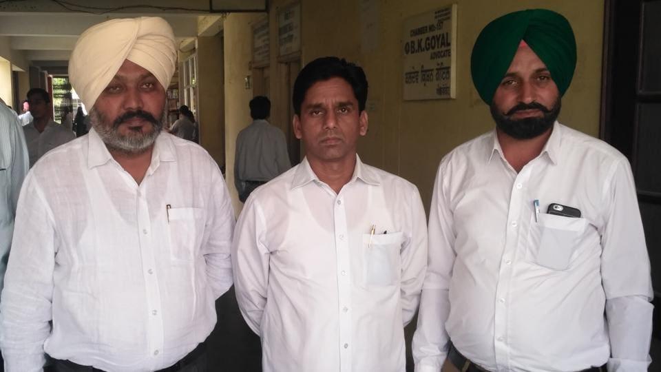 AAP MLAs Harpal Singh Cheema (left) and Naresh Yadav (centre) at Sangrur court on Monday.