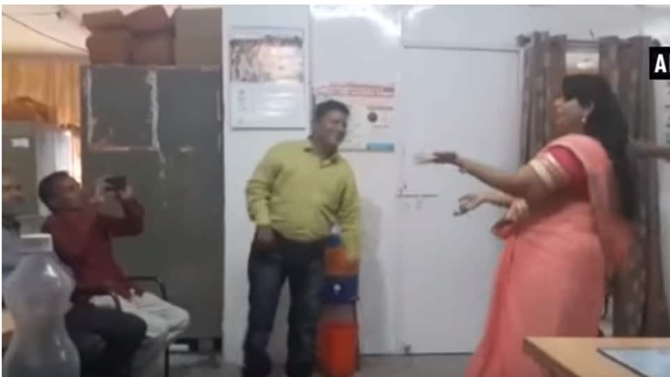 Screenshot from a youtube video of women and child development department employees in Madhya Pradesh dancing in the office.