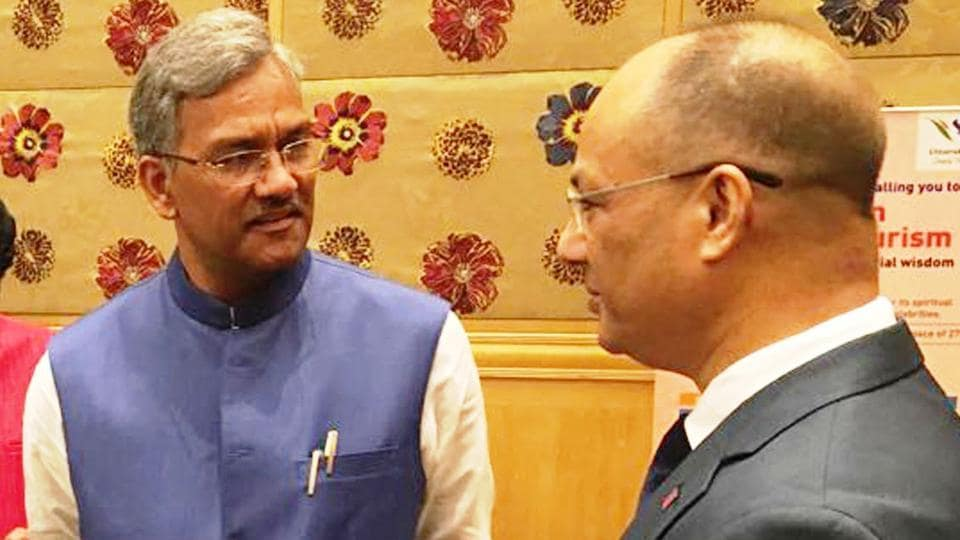 Chief minister Trivendra Singh Rawat (L) with a Thai official at a seminar in Bangkok on Tuesday.