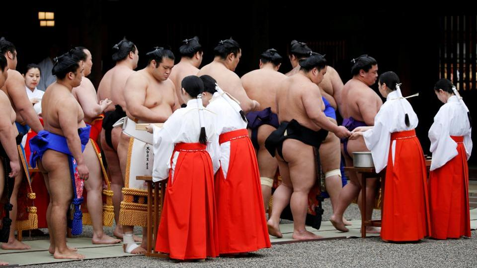 "Sumo wrestlers take part in a Shinto ritual before the tournament dedicated to the Yasukuni Shrine begins. One of the more controversial 'don'ts' within the sport, although not mentioned on Monday, is the tradition that forbids women from entering the ring on the grounds that it is sacred and their presence, considered ""unclean"", would pollute it. (Toru Hanai / REUTERS)"