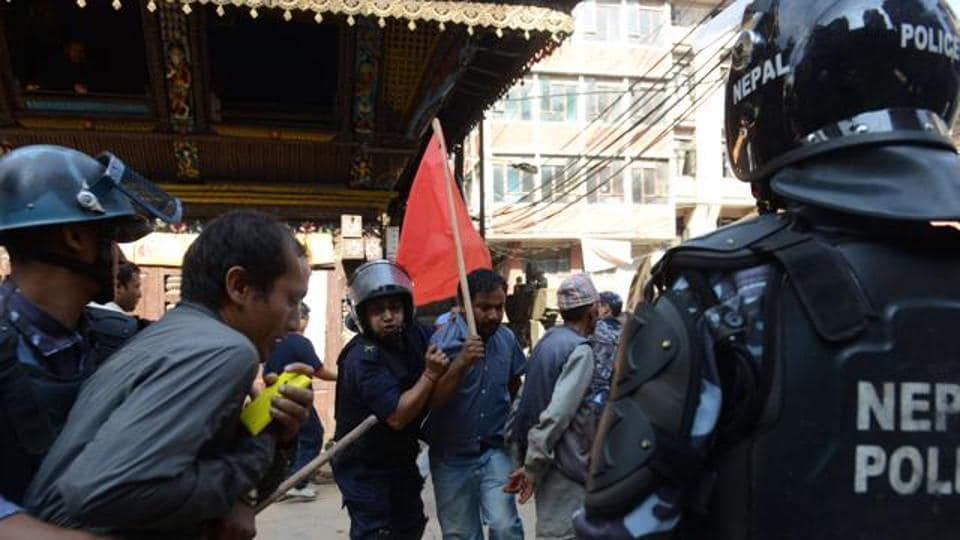 Nepalese police arrest a demonstrator during a general strike called by a hardline breakaway faction of former Maoist rebels in 2015. It is suspected a Maoist faction led by Netra Bikram Chand, known for its anti-India rhetoric, could be behind the explosion.