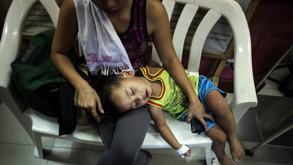 "Kyle Valdez, 2, who has not been injected with Dengvaxia, with his at the Dengue/Dengvaxia Express Lane at a hospital in Manila. Sanofi has noted in March: ""No causal-related deaths were reported in 15 countries after clinical trials conducted for more than a decade with 40,000 subjects involved."" But that hasn't stopped allegations emerging of vaccinated children dying of super-charged cases of dengue after Dengvaxia. (Noel Celis / AFP)"