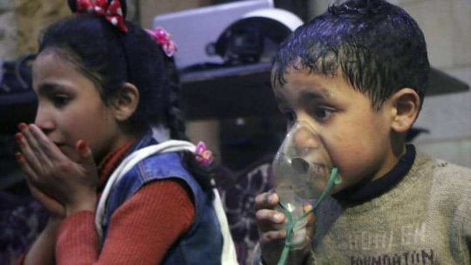 This image released on April 8, 2018, by the Syrian Civil Defense White Helmets, shows a child receiving oxygen through respirators following an alleged poison gas attack in the rebel-held town of Douma, near Damascus, Syria.
