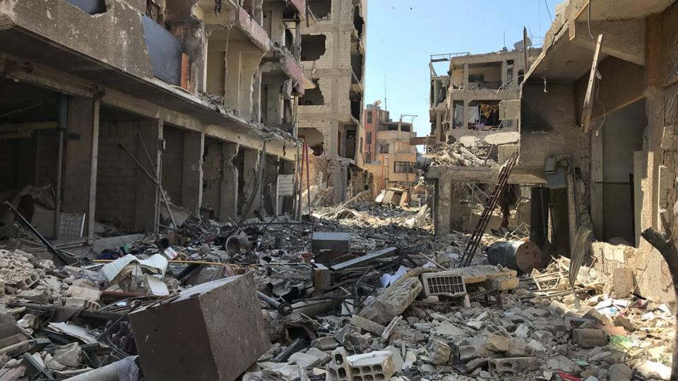 Rubble fills a street in Douma, the site of a suspected chemical weapons attack, near Damascus, Syria, Monday, April 16, 2018