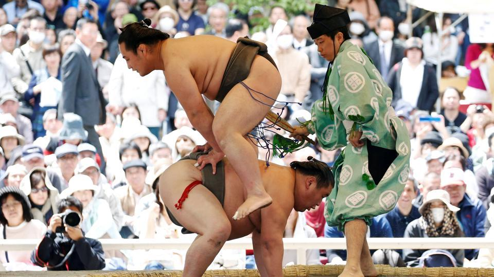 Wrestlers perform a show fight during the annual sumo tournament. The audience gathered was treated to exhibition bouts, preceded by time-honoured foot-stamping ceremonies, as well as traditional chanting and even a comedy routine explaining the dos and don'ts of sumo wrestling. (Toru Hanai / REUTERS)