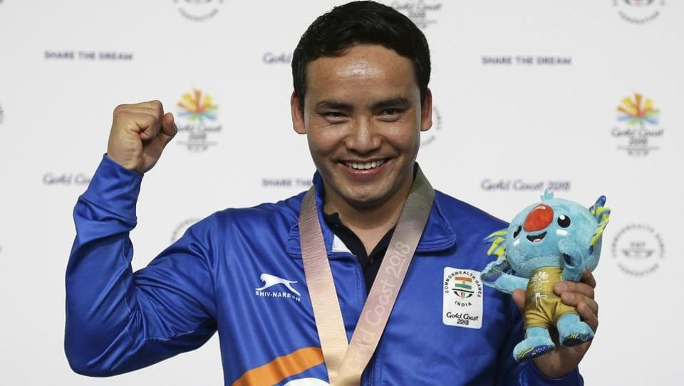 Jitu Rai of India poses with his gold medal in the men's 10m Air Pistol final at the 2018 Commonwealth Games in Gold Coast.
