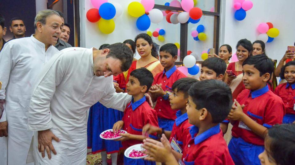 Congress President Rahul Gandhi interacts with school children during the opening ceremony of a private school in Amethi on Tuesday.