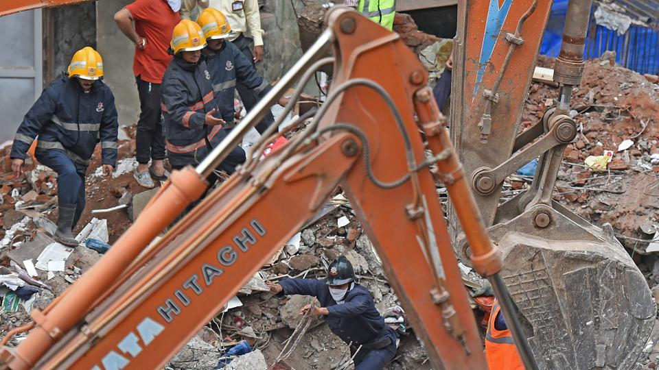 Mumbai Fire Brigade officers carry out rescue operation at the site of the Sai Siddhi building collapse in Ghatkopar in July 2017. The collapse killed 17 people.