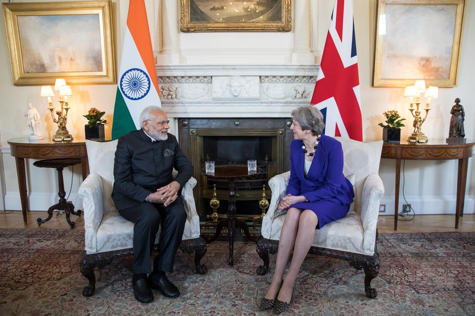 British Prime Minister Theresa May (R), speaks to Prime Minister Narendra Modi during their bilateral meeting at 10 Downing Street, London. Modi arrived in London early on Wednesday to attend the Commonwealth Heads of Government Meeting (CHOGM) as he looks to enhance India's role in multilateral organisations. He is the first Indian PM to attend the meet in nearly a decade. (Simon Dawson / Bloomberg)