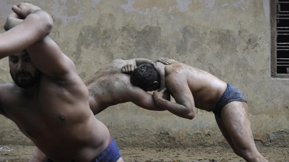 In such times of economic uncertainty, the 'dangal' season which begins in August is a windfall for wrestlers as organizers place bets on them according to the tournaments they have participated in. A national level wrestler for instance, can easily fetch a bet of Rs 30,000 whereas an Asian Games wrestler gets a bet as high as Rs 50,000. (Sunil Ghosh / HT Photo)