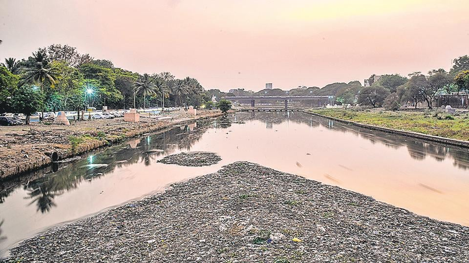 Polluted Mutha river as seen from the bridge near Omkareshwar temple on Monday.