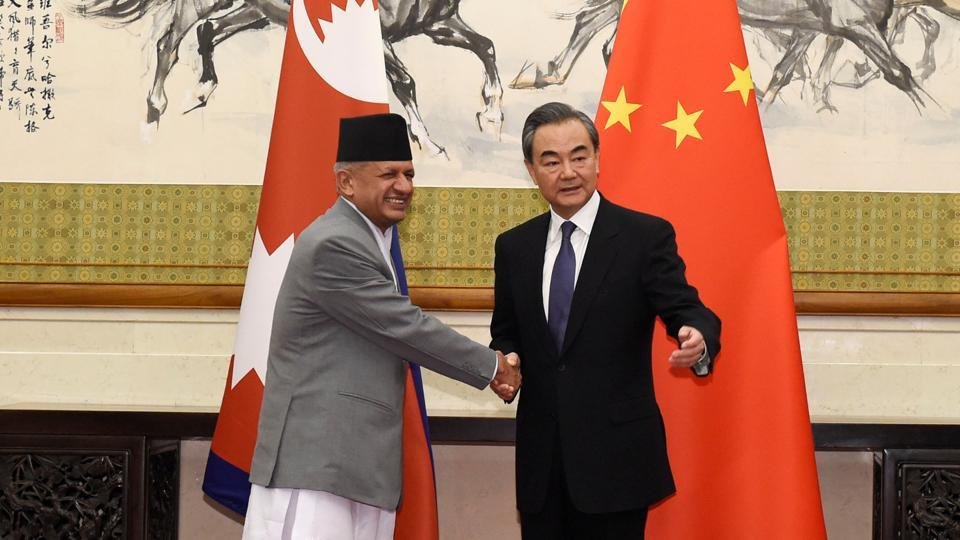 Nepalese foreign minister Pradeep Kumar Gyawali (left) shakes hands with Chinese foreign minster Wang Yi at the Diaoyutai State Guesthouse in Beijing on April 18, 2018.