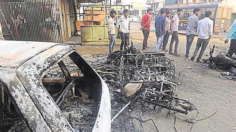 Torched vehicles at Bhima Koregaon  violence in Pune.