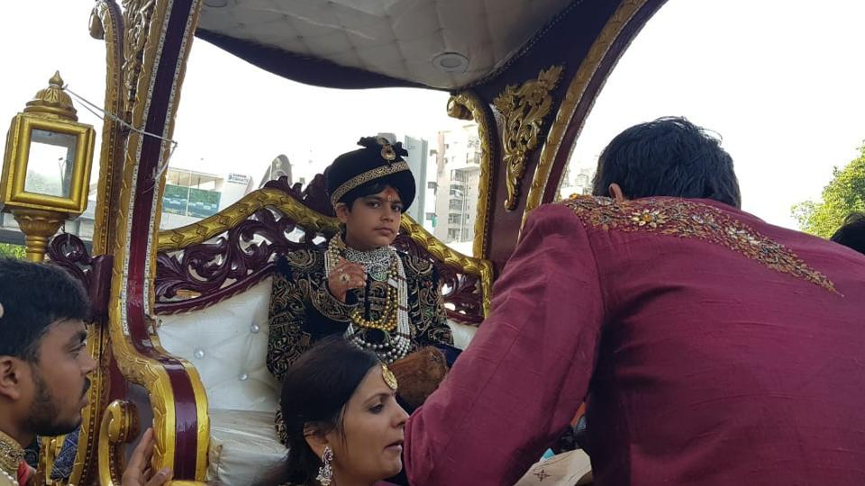 Bhavya Shah rides a chariot in Ahmedabad before joining a order of Jain monks.