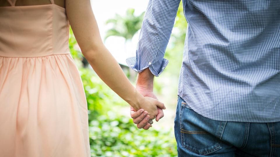 Spouses may be able to notice suspicious moles on their partners that could signal melanoma.