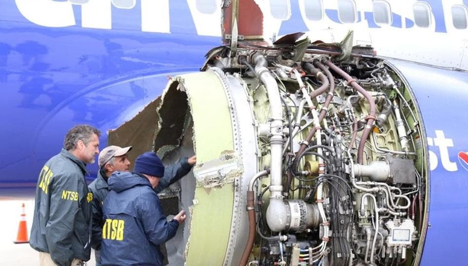 US NTSB investigators on scene examining damage to the engine of the Southwest Airlines plane, on Tuesday.