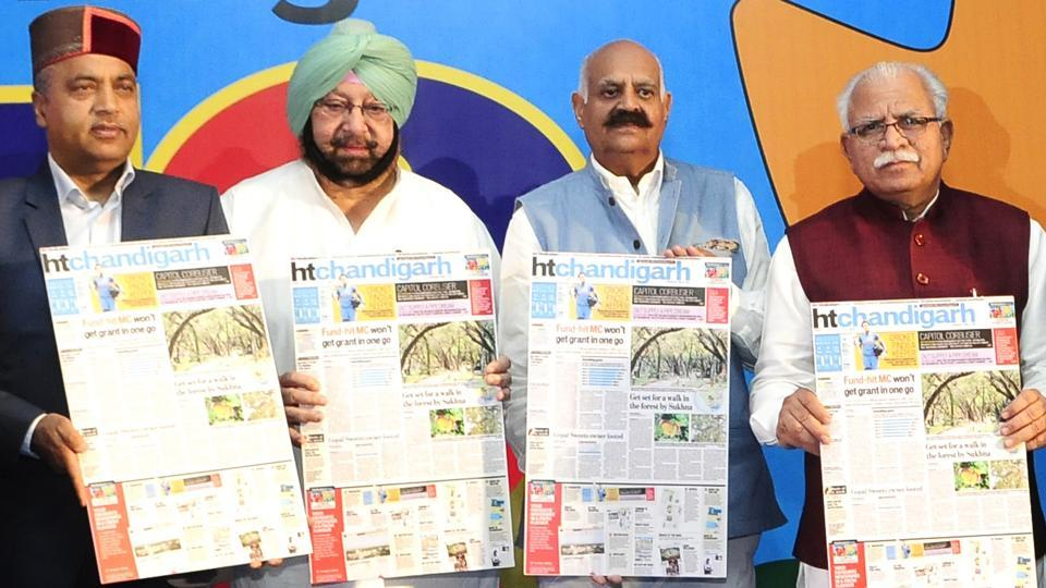 (left to right) Himachal Pradesh CM Jai Ram Thakur, Punjab CM Capt Amarinder Singh, Punjab governor VP Singh Badnore and Haryana CM Manohar Lal Khattar unveil the new look of  HT Chandigarh edition during the event.  (Keshav Singh/HT)