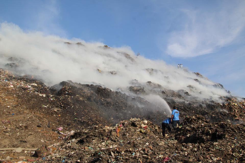 Firefighters at Adharwadi landfill on Thursday.