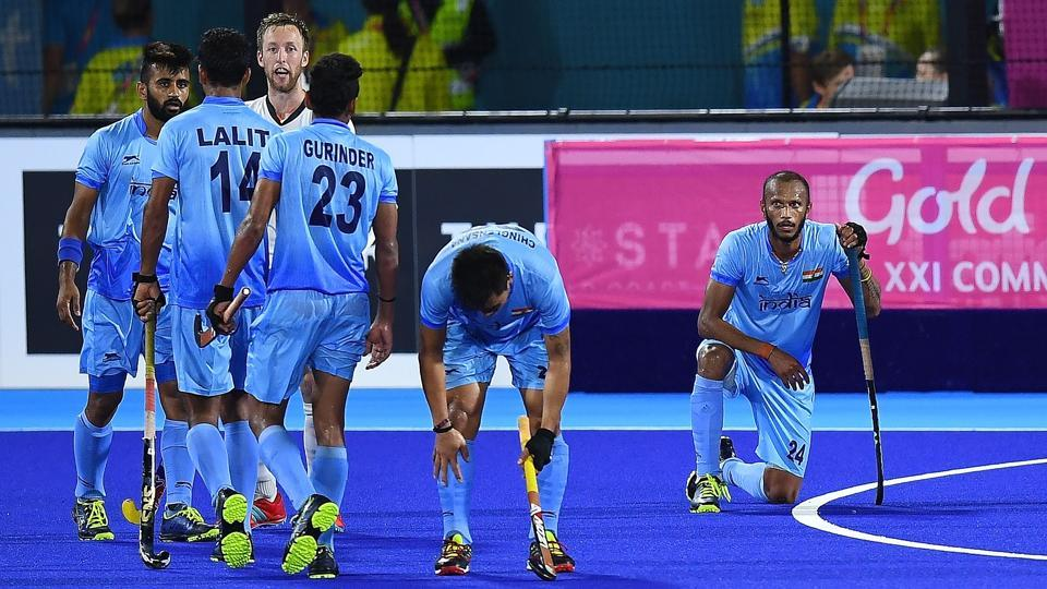 India's hockey team players sit dejected on the pitch after losing to England during their men's field hockey bronze medal match of the 2018 Gold Coast Commonwealth Games at the Gold Coast Hockey Centre on the Gold Coast on April 14, 2018.