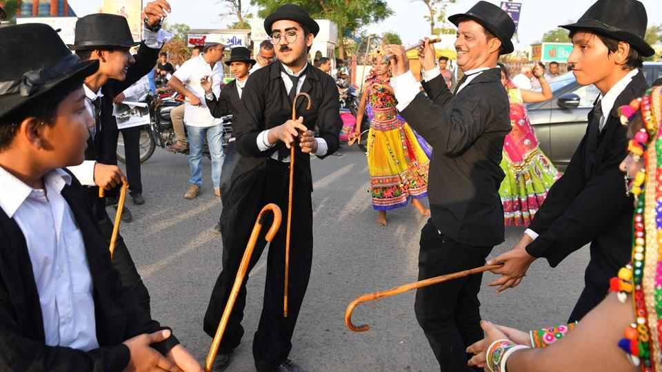 Mavani (C) breaks into a jig with other impersonators. He was four when he started acting and has been celebrating Chaplin's birthday ever since then with his grandfather. And he looks to follow in his grandfather's footsteps by succeeding Aswani as president of the Charlie Circle. (Indranil Mukherjee / AFP)