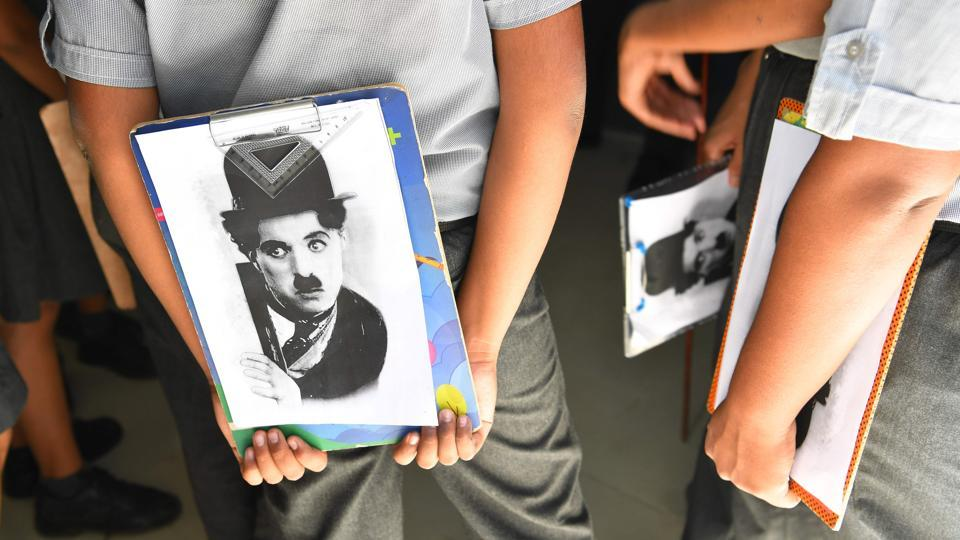 A drawing competition was also organized by the club to commemorate the legendary actor's birthday,with the subject none other than the silent actor's portrait.  (Indranil Mukherjee / AFP)