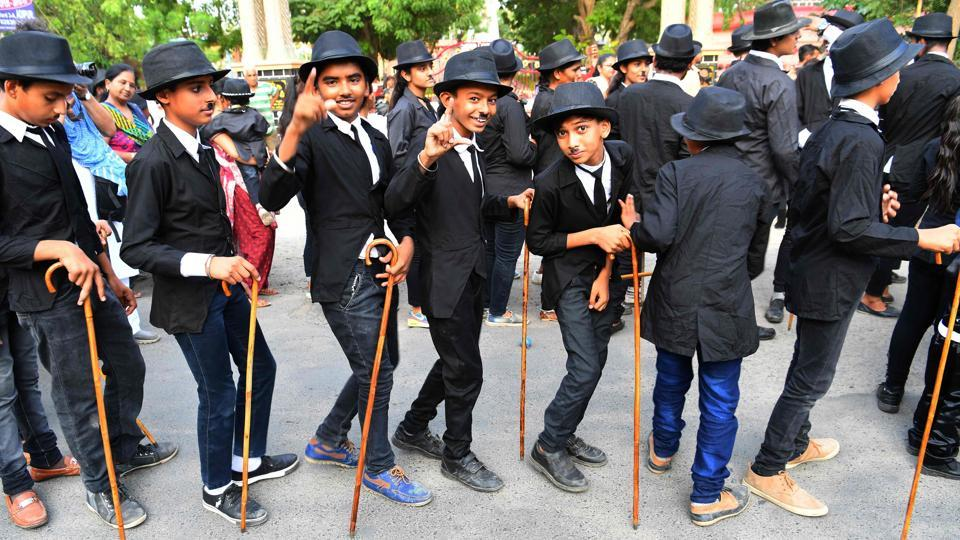 Young Charlie Chaplin impersonators pose for a picture during the event. On Monday, Aswani was joined by roughly 300 others, a solid turnout for an event that started with one man. Children wore Chaplin face masks while some carried life-sized cut-outs of the English-born filmmaker as a stereo loaded onto a truck belted popular Bollywood songs. (Indranil Mukherjee / AFP)