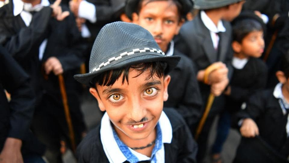 Wearing bowler hats and fake moustaches while carrying walking sticks, hundreds of Charlie Chaplin fans shuffled bow-legged through Adipur in Gujarat to celebrate the comic actor's 129th birthday this week. Every year on April 16, residents of Adipur honour the legendary silent actor's birthday by imitating his slapstick style in a parade. (Indranil Mukherjee / AFP)