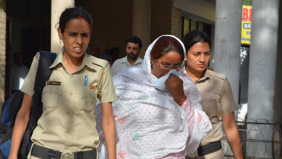 Main accused Jaswanti Devi (in white) leaves a Panchkula CBI court after she was convicted in the Apna Ghar sexual exploitation case on Wednesday.