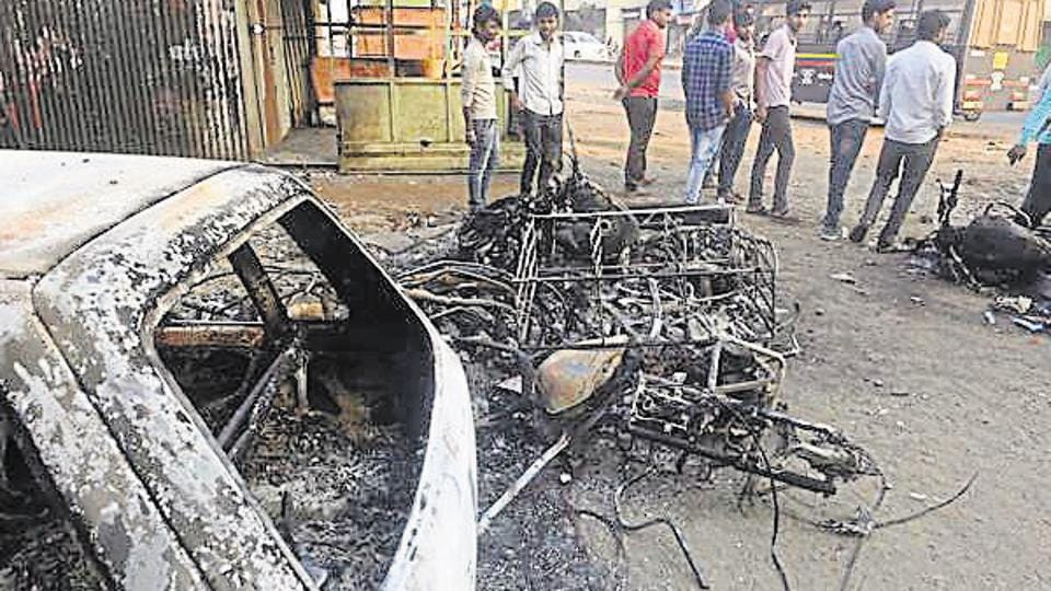 Pune, India - January 2, 2018: Torched vehicles at Koregaon Bhima in the violence in Pune, India, on Tuesday, January 2, 2018. (Photo by Pratham Gokhale/Hindustan Times)