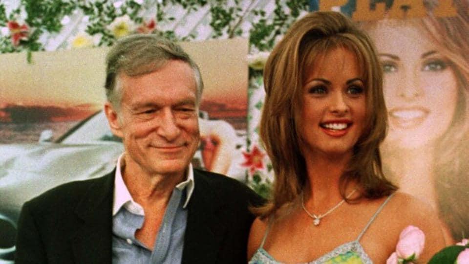 Former Playboy model Karen McDougal poses with Playboy magazine founder and editor in chief Hugh Hefner.