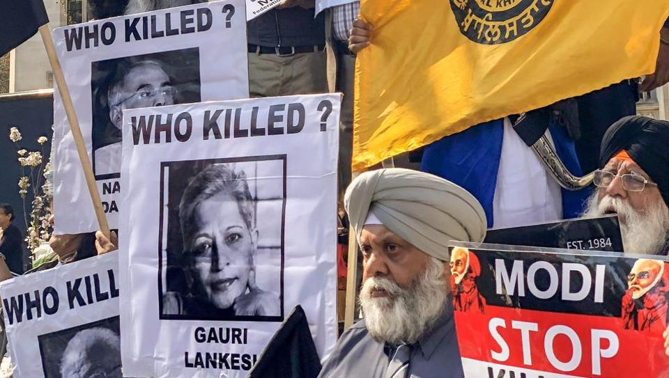 Members of the Sikh community protest against Prime Minister Narendra Modi in London on Wednesday.  Modi is in UK as a part of a five-day international tour.