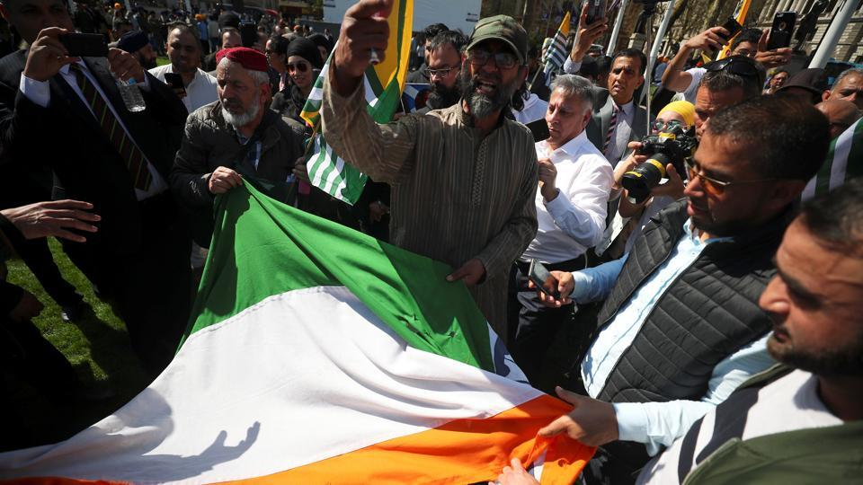 Protesters ripped up India's flag after tearing it off a flagpole in Parliament Square, London, on April 18, 2018.