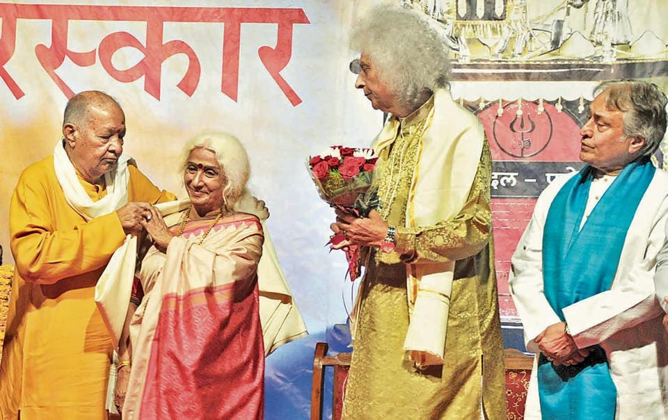 Prabha Atre felicitated with Punyabhushan award by (from L) Pandit Hariprasad Chaurasia and Pandit Shivkumar Sharma in the city on Thursday.
