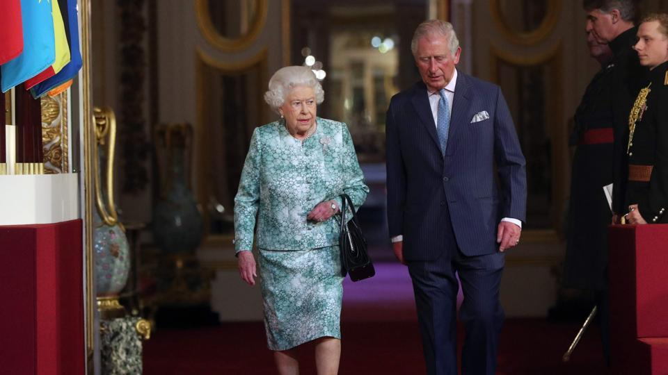 Britain's Queen Elizabeth II and Britain's Prince Charles, Prince of Wales arrive for the formal opening of the Commonwealth Heads of Government Meeting (CHOGM), in the ballroom at Buckingham Palace in London on April 19, 2018.