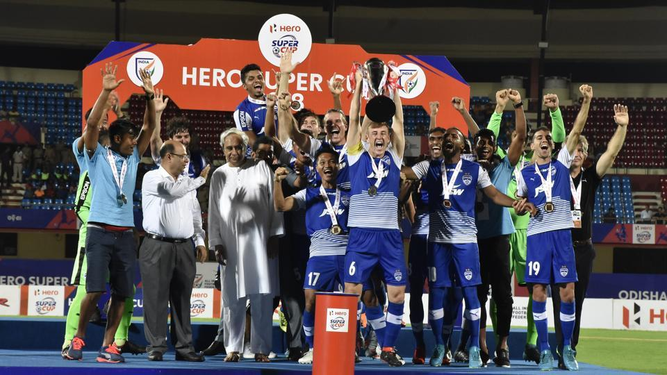 Bengaluru FCplayers celebrate with the Super Cup after beating East Bengal in the final on Friday.