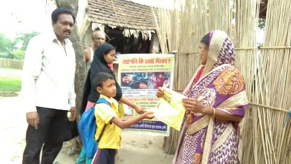 AsaduddinSadique and his children, Sultan Abid and Sabiha Shabnam, distribute pamphlets to persuade people to stay away from violence during elections.