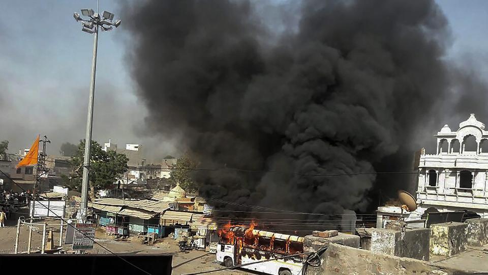 Smoke billows out of a burning bus during Bharat Bandh, called by Dalit organisations, Alwar, Rajasthan, April 2