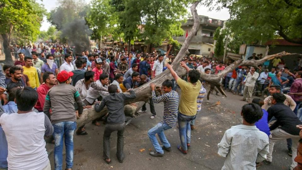 Members of the Dalit community block a road as they protest against the alleged 'dilution' of SC/ST Act, in Ahmedabad. The Centre has moved the SC seeking a review of its order.