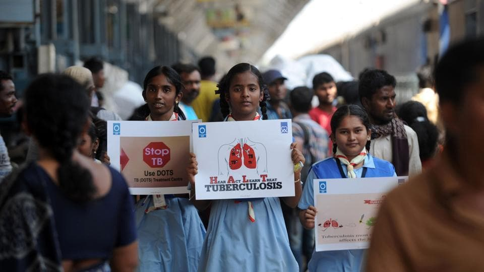 Schoolchildren hold placards as they take part in a tuberculosis awareness campaign at a railway station in Chennai. An estimated 1,47,000 people suffer from multi-drug resistant (MDR) TB in India.